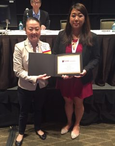 Dr. Esther Kim with Travel Grant Winner Olivia Yau.