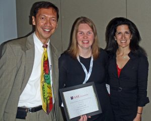 2015 Travel grant recipient Sara Swanson, MD (center), receive congratulations from Council Past Chair Leo Lopez MD, FASE (left) and Council Chair Meryl Cohen, MD, FASE